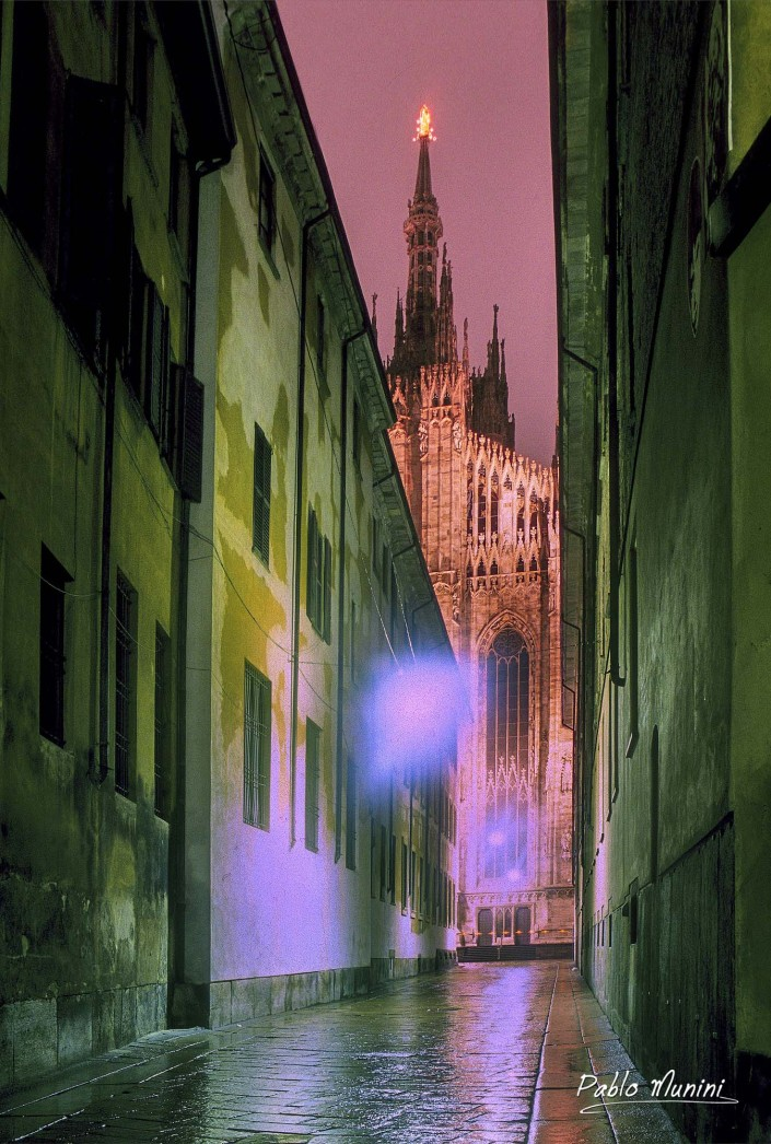 lateral view of the cathedral in Milan on a rainy evening , 2004.