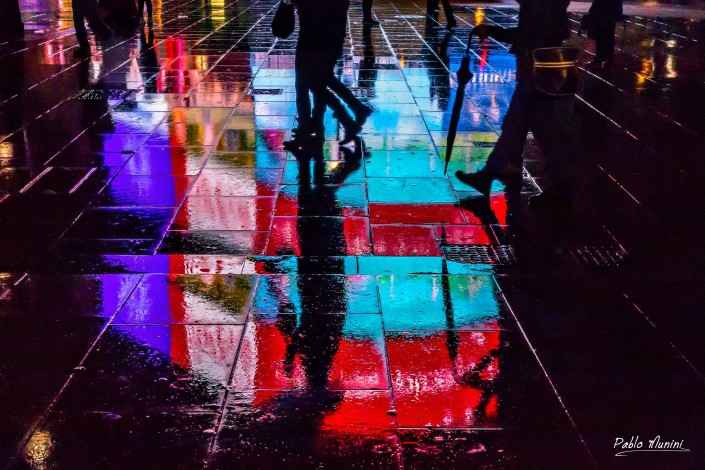 Reflections oLights Pavement rain In Piccadilly Circus London .London night photography.London street photography. London monuments illuminated.