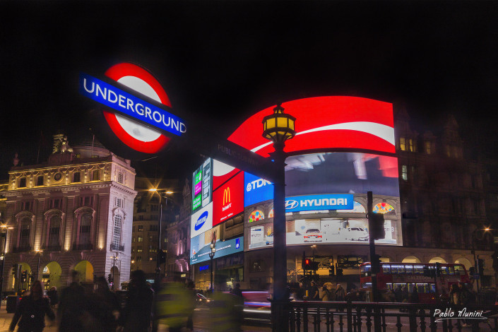 Picadilly Circus underground at night. London urban photography. London street photography.London travel photography. Best photos of London. Top images of central London. Picadilly circus at night.