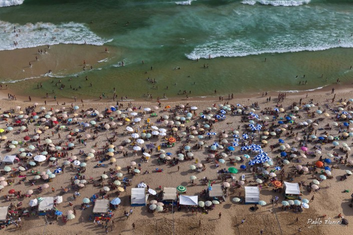 elevated view of Ipanema , crowded sunday afternoon.Pablo Munini