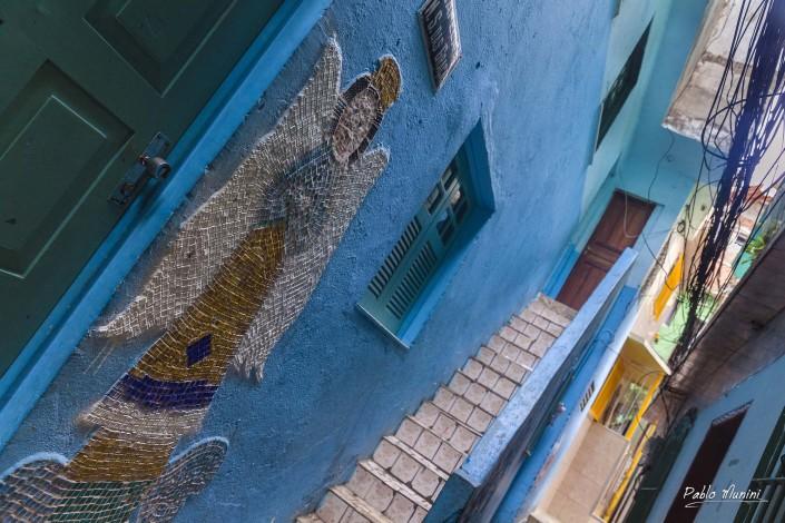 front of a house oin narrow street at favela Vila Canoas, Rio de Janeiro, Pablo Munini.