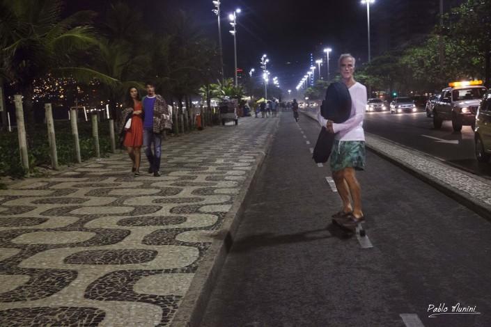 Carioca Brazilian skate carrying a guitar along the beachfront.Pablo Munini