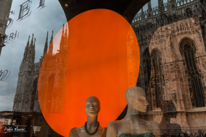 Reflections of Milan cathedral on Vittorio Emanuele street 's showcases.Pablo Munini