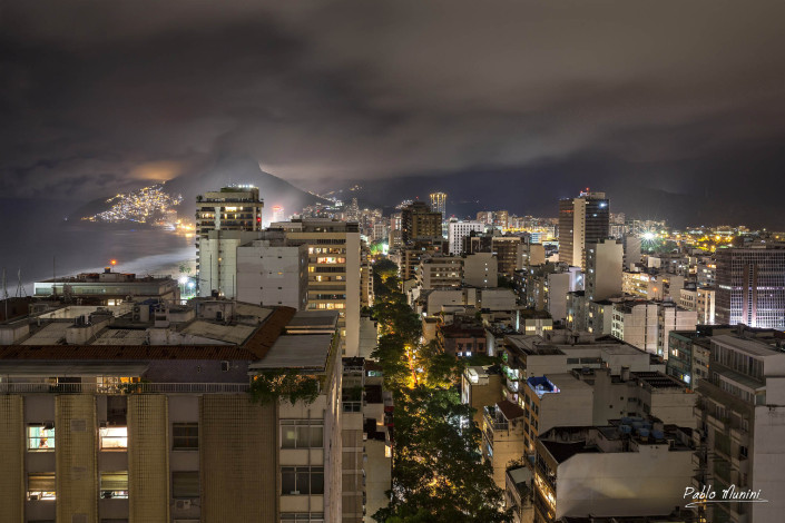 view over tops of residential buildings and mountains in Ipanema Rio, Pablo Munini