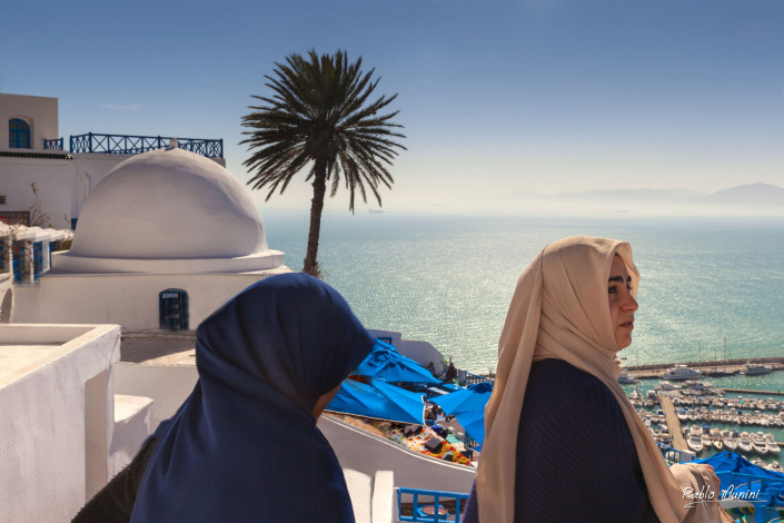 Sidi Bou Said sits atop a steep cliff overlooking the Mediterranean Sea.known as an Artists village.German-Swiss painter Paul Klee.Sidi Bou Said the white and blue village.ribat.Cafe des Nattes.
