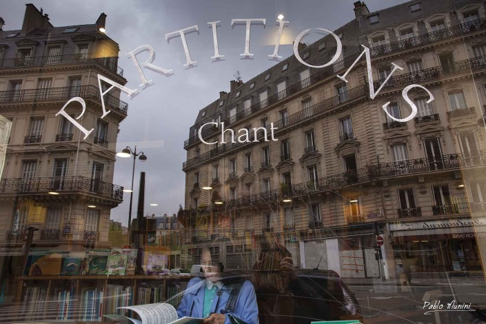 parisian buldings reflected on a music store window in Rome street, Paris.Pablo Munini