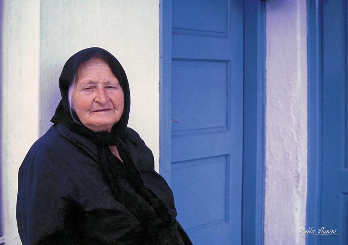 colors of Mykonos . blue doors. Mykonos images. Mykonos phogallery. old women in mykonos black dress. Images of Greece.