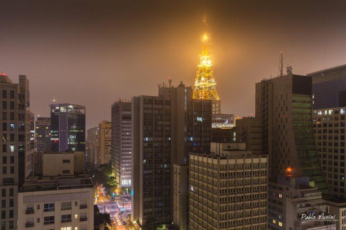 foggy evening buildings São Paulo sinous shape Cásper Líbero. l argest and most populous city of Brazil Television tower.Avenida Paulista night photophaphy