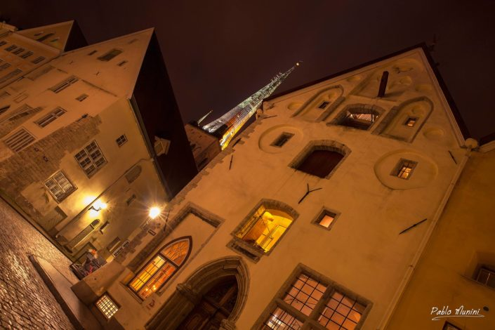 facades of gothic houses of Pikk tänav at night, St. Olav's church tower.Pablo Munini