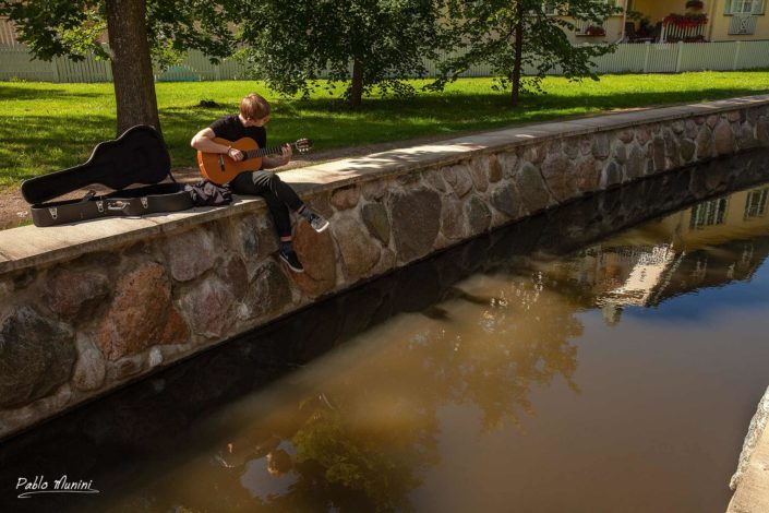 young estonian playing the guitar , Kadriog park.Tallin, Pablo Munini.