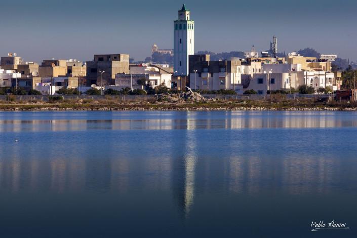 """reflection minaret La Goulette italian fishing village Tunisia.cospicua comunità italiana esponenti di spicco l'attrice Claudia Cardinale """"Piccola Sicilia""""."""