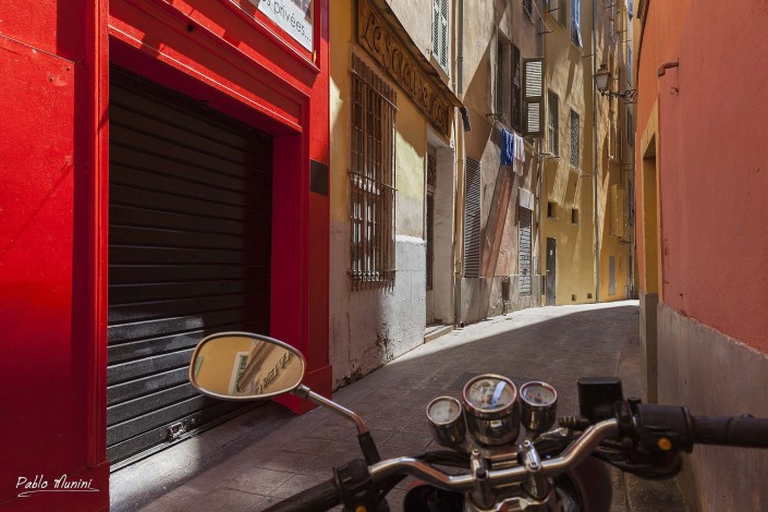 Narrow coloured street of Old Nice France.Images architecture Nice. French Riviera images.tribute to Nice. Cote d'Azur pictures. Cote d'Azur photos.