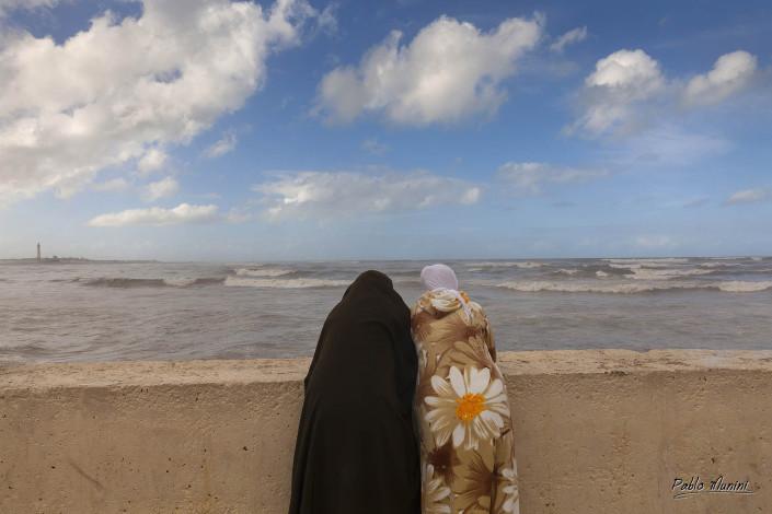 Atlantic ocean cost Casablanca.Morocco photography.Travel photography Morocco.muslim women contemplating coast Casablanca Morocco.Atlantic ocean cost Casablanca.Morocco photography. People Casablanca.Life Morocco.