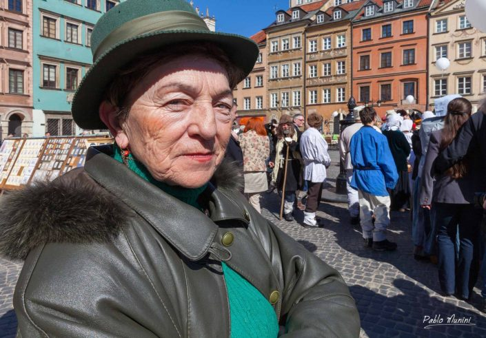 portrait of polish woman Warsaw Old Town Market Square.Phoenix city Warsaw Photography square cobblestone square ornately painted townhouses renaissance architecture reconstructed,Warsaw's heart and soul 18th century. Warsaw landmark best photography.fairscity festivities public executions.Warsaw Mermaid,city symbol.